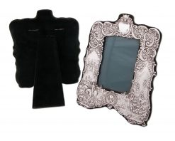 A Rare and exquisite pair of Asprey's Silver Fox Hunting Photograph Frames together with matching hand mirror and a pair of hair brushes Embossed with a fox hunting scene, starting at the meet with Country House in the background following through to hounds in full cry, fox masks, hounds heads, hunting horns, whips etc. The frames have bottle green watermark silk and velvet lining.