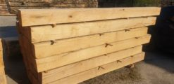 Structural Green Oak Beams 150mm x 150mm - 6 inches x 6 inches & Equestrian Estate Oak Fencing. Our fresh cut green oak beams are ideal for structural use both internal and external projects. These green oak beams are unseasoned and will be of a higher moisture content which makes these beams easier to cut into custom profiles, shapes required to suit. Hampshire, Sussex, Wiltshire, Somerset, Berkshire, Kent, Cotswolds, Gloucestershire