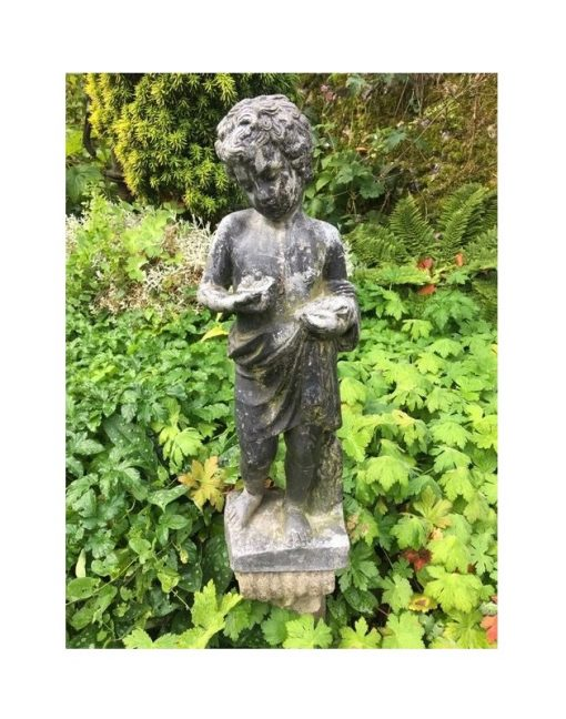 Antique Lead Garden Figure of a boy with nest and chicks